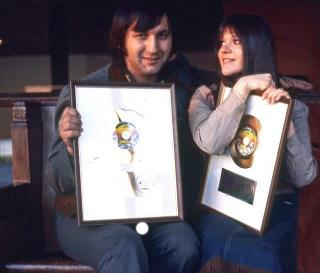 Melanie and Peter shwoing the golden record of Brand New Key